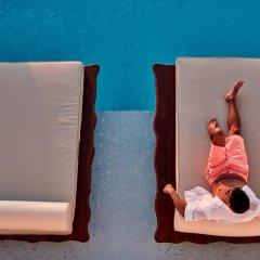 Отель Astra Suites фитнесс-зал фото 3