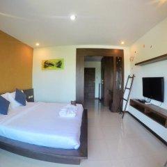 Отель Benjamas Place Номер Делюкс с различными типами кроватей фото 5