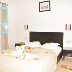 Отель Menzel Dija Appart-Hotel Тунис, Мидун - отзывы, цены и фото номеров - забронировать отель Menzel Dija Appart-Hotel онлайн комната для гостей фото 5
