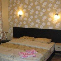 Апартаменты Малон Апартаменты комната для гостей фото 3