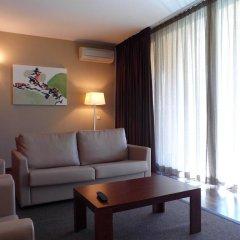 Апартаменты Salgados Palm Village Apartments & Suites - All Inclusive комната для гостей