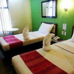 Отель Express Inn Cebu 3* Улучшенный номер с различными типами кроватей фото 3