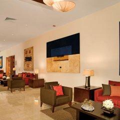 Отель Dreams Palm Beach Punta Cana - Luxury All Inclusive Доминикана, Пунта Кана - отзывы, цены и фото номеров - забронировать отель Dreams Palm Beach Punta Cana - Luxury All Inclusive онлайн интерьер отеля
