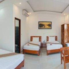 Отель Tra Que Flower Homestay Стандартный номер с различными типами кроватей фото 5