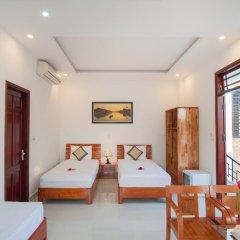 Отель Tra Que Flower Homestay Стандартный семейный номер с двуспальной кроватью фото 5