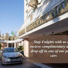 Отель Amman International парковка