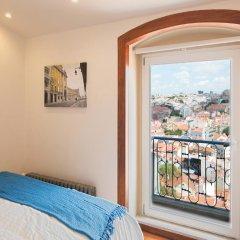 Отель Traveling To Lisbon Castelo Apartments Португалия, Лиссабон - отзывы, цены и фото номеров - забронировать отель Traveling To Lisbon Castelo Apartments онлайн комната для гостей фото 2