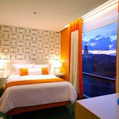 Отель The Bayleaf Intramuros 3* Номер Премьер с двуспальной кроватью фото 2