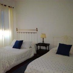 Отель Casa do Cerrado Стандартный семейный номер разные типы кроватей фото 5