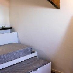 Отель Porto Beach House сейф в номере