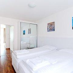 Апартаменты Premium Apartments By Livingdowntown Цюрих комната для гостей фото 4