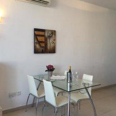 Отель Saint Julian's - Sea View Apartments Мальта, Сан Джулианс - отзывы, цены и фото номеров - забронировать отель Saint Julian's - Sea View Apartments онлайн комната для гостей фото 3