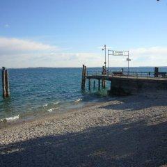 Отель Montecolo Resort Манерба-дель-Гарда пляж