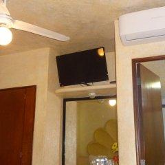 Отель Villas La Lupita удобства в номере