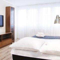 Отель Hosapartments City Center Улучшенные апартаменты с различными типами кроватей фото 3