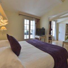 Отель Suites Unic Renoir Saint-Germain Франция, Париж - отзывы, цены и фото номеров - забронировать отель Suites Unic Renoir Saint-Germain онлайн комната для гостей фото 4