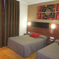 Отель Hostal Abadia Стандартный номер с 2 отдельными кроватями фото 2