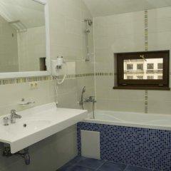 Гостиница Alm 4* Семейный люкс с двуспальной кроватью фото 6