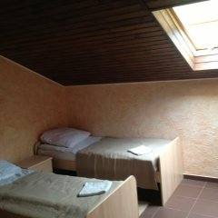 Гостевой дом «Виктория» Стандартный семейный номер с разными типами кроватей фото 4