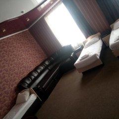 Гостиница Олимп Стандартный семейный номер с двуспальной кроватью