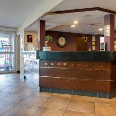 Отель Econo Lodge South Calgary Канада, Калгари - отзывы, цены и фото номеров - забронировать отель Econo Lodge South Calgary онлайн интерьер отеля фото 3
