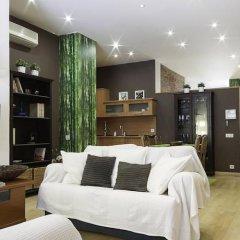 Апартаменты Home Around Gracia Apartments Барселона комната для гостей фото 2