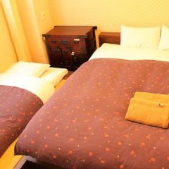 Отель K's House Tokyo Oasis Кровать в общем номере фото 9