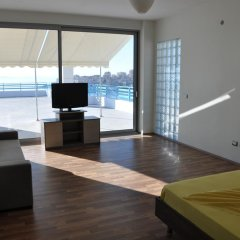 Апартаменты Apartments Serxhio комната для гостей фото 4