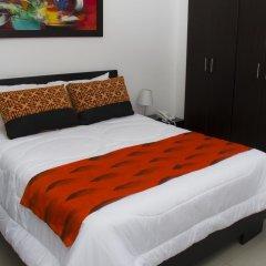 Отель Ofihotel Peñon Suites Колумбия, Кали - отзывы, цены и фото номеров - забронировать отель Ofihotel Peñon Suites онлайн комната для гостей фото 3