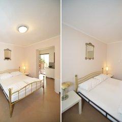 Апартаменты Tianis Apartments комната для гостей фото 2
