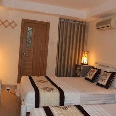Legend Saigon Hotel Семейный номер Делюкс с двуспальной кроватью фото 2