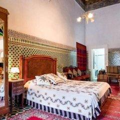 Отель 2 BR Charming Apartment Fes Марокко, Фес - отзывы, цены и фото номеров - забронировать отель 2 BR Charming Apartment Fes онлайн комната для гостей фото 3
