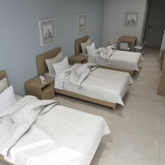 Palm Bay Hotel Studios комната для гостей