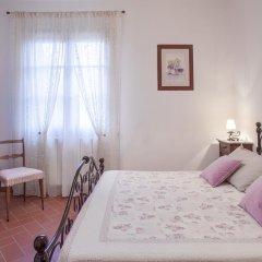 Отель Agriturismo Tra gli Ulivi Кастаньето-Кардуччи комната для гостей фото 4