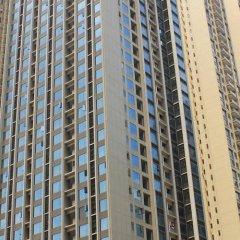 Апартаменты She & He Service Apartment - Huifeng спортивное сооружение