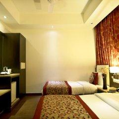Отель The Prime Balaji Deluxe @ New Delhi Railway Station 3* Номер Делюкс с различными типами кроватей фото 8