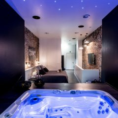 Отель Chambre Avec Jacuzzi Sauna Privatif Улучшенные апартаменты фото 5