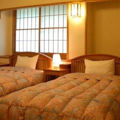 Отель Yamabiko Ryokan Минамиогуни комната для гостей фото 5