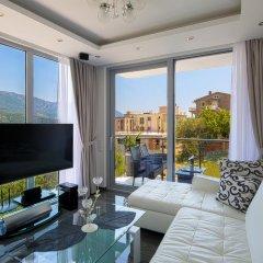 Апартаменты Montelux Apartments комната для гостей