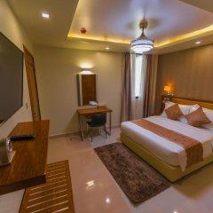 Отель Unima Grand 3* Улучшенный номер с различными типами кроватей фото 4