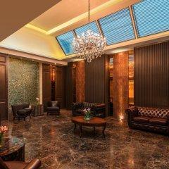 Отель Radisson Suites Bangkok Sukhumvit Бангкок интерьер отеля