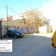 Отель Abadia Suites парковка