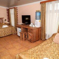 Гостиница Охотничья Усадьба Стандартный семейный номер с разными типами кроватей фото 4