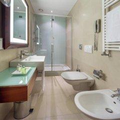 Отель NH Milano Touring 4* Стандартный номер разные типы кроватей фото 22
