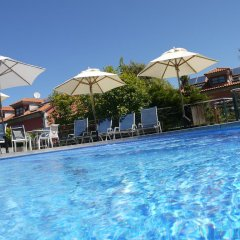 Отель Apartamentos Cueto Mazuga I бассейн