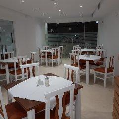 Отель Delfini Албания, Саранда - отзывы, цены и фото номеров - забронировать отель Delfini онлайн питание
