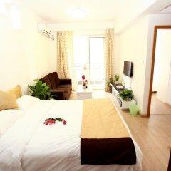 Апартаменты Jietai Xingzheng Apartment комната для гостей фото 4