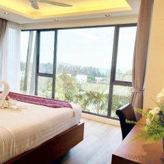 Отель At The Tree Condominium Phuket комната для гостей