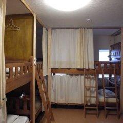 Отель Aza Fukuoka Seminar House Кровать в мужском общем номере