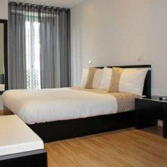 Отель VivaCity Porto Улучшенный номер разные типы кроватей фото 10